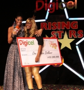 Brown Sugar poses with her cheque of 1 million dollars with Digicel Rising Stars Season Host, Yendi Phillipps.